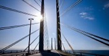 bridge_with_sun_shining_through_spans
